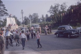 Photo:Bunting and a donkey outside the pub as the crowd follows the carnival in 1963