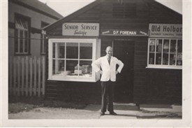 Photo:Dave Foreman outside The Stores 1958, with the old WI hall on the left