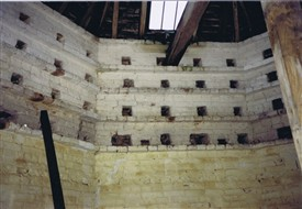 Photo:The dovecote interior in February 1988, note the lower nests have been bricked up